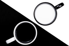 Black and white. Cups on white and black backgrounds contrast concept Royalty Free Stock Image