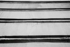 Black and white abstract background from horizontal lines of a building, photo. Black and white abstract background from horizontal lines of a building Stock Images