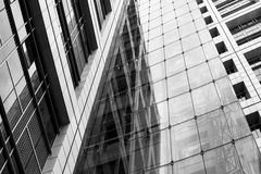 Black and white abstract building wall made of steel and glass. High urban impressive modern construction concept. Monochrome business center view. Finance Royalty Free Stock Photos