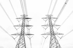 Black & white abstract hight voltage tower line on the sky backg Stock Photography