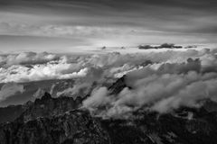 Black and White Aerial Mountain Landscape. Beautiful aerial landscape view of SkyPilot Mountain covered in clouds. Picture taken near Squamish, British Columbia Stock Photography