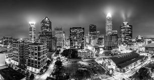 Black and white, aerial view of Charlotte, NC skyline. On a foggy night. Charlotte is the largest city in the state of North Carolina and the 17th-largest city Stock Images