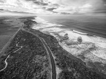 Black and white aerial view of the great ocean road with Gog and Royalty Free Stock Images