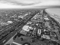 Black and white aerial view of Patterson Lakes and Nepean Highwa. Black and white aerial view of Patterson Lakes suburb and Nepean Highway at sunrise. Melbourne stock image