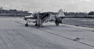 Black and white airplane covered in burlap rags Royalty Free Stock Images