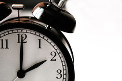 black and white alarm clock Stock Images