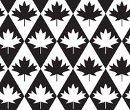 Black and white alternating maple leaves on diamonds Stock Photos