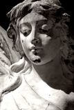 Black and White Angel. Antique Grave Monument Featuring Beautiful Female Angel royalty free stock photography
