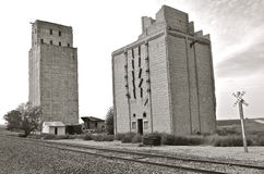Black and white:Antiquated old concrete poured grain elevators Royalty Free Stock Photos