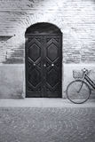 Black and white antique facade and bicycle Stock Photo
