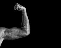 Black and white arm on black background royalty free stock photography