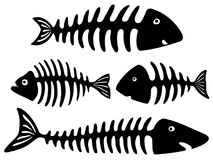 Black and white art with fish bones. Cartoon black silhouettes of fish skeletons on white background Stock Photo
