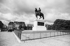 Black and white art monochrome photography. A beautiful European city. Euro-trip. Monument to Henry IV in Paris. Travel through Europe. Attractions in France royalty free stock photography