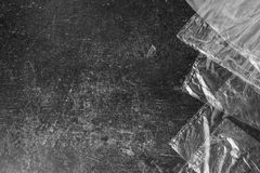 Black and white art monochrome photography. Cellophane bags on a dark marble background. Polute the nature. Eco concept Royalty Free Stock Photo