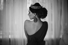 Black and white art monochrome photography. Girl brunette in dress with beautiful hairstyle, earrings of beads and a crown royalty free stock photos