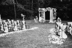 Art black and white photography. Wedding decorations. Black and white art photography monochrome, beautiful wedding ceremony outdoors. Wedding arch made of cloth Stock Photo