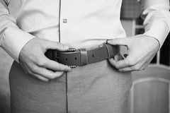 Creative black and white photography. Black and white art photography monochrome, man buttons belt. Men`s style. Professions. To prepare for work Royalty Free Stock Images