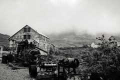 Black and white view of the abandoned Independence Mine along Alaska`s Hatcher Pass. Black and white artistic photo of Alaska`s abandoned Independence Mine up on royalty free stock image