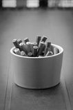 Black & White ashtray. Ashtray full of cigarettes in Black and white version Royalty Free Stock Images