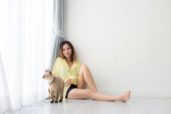 Black and white Asian woman with her cat Stock Photo