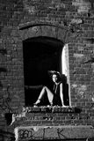 Black and white attractive girl posing in an old building collapsed Royalty Free Stock Images