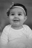 Black and White Baby Girl. A black and white portrait of a smiling one year old girl Royalty Free Stock Photo