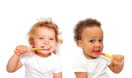 Black and white baby toddlers brushing teeth Stock Images