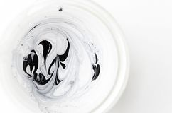 Abstract mixed two kind of paint - white and black.Top view royalty free stock photos