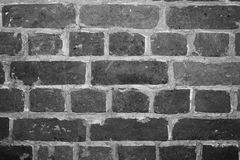 Black and white background of the brick wall close-up inside the ancient house. Background, texture.  stock photo