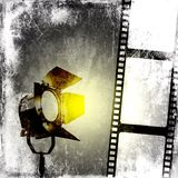Black and white background with film strip and reflector. Design element Stock Photography