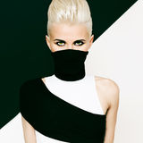 Black and white background girl ninja style. fashionable hairsty Royalty Free Stock Images
