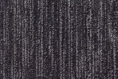 Black and white background of a knitted textile material. Fabric with a striped texture closeup. Royalty Free Stock Photo