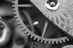 Black white background with metal cogwheels a clockwork. Macro Royalty Free Stock Photo