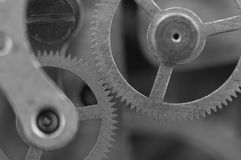 Black white background with metal cogwheels a clockwork. Royalty Free Stock Photography