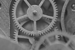 Black and white background with metal cogwheels inside clockwork Stock Photography