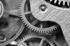 Black and white background with metal cogwheels inside clockwork Stock Photos