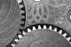Black white background with metal cogwheels a old clockwork. Royalty Free Stock Photo