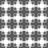 Black and white background. Symmetrical repetition. Seamless pattern. The cross-stitch. Yellow, red, green, and black colors. Crafts and Hobbies. Black and Stock Images
