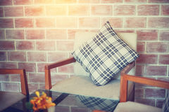 Black and white backrest pillow on chair Stock Photography