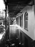 Black white Balcony View. Black and White Balcony view with blurred electrical fans due to low shutter speed Old fashion Floridian house with balcony and arched Stock Photography