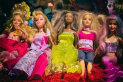 Black and white barbie dolls. Multiethnic barbie toy dolls with fancy dresses in a memorabilia store display. Girl background wallpaper image royalty free stock images