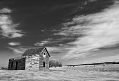 Black and White Barn. An isolated old barn on the Alberta Prairies Stock Photography