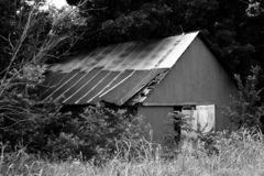 Black & White Barn. Old barn photo taken in black and white royalty free stock image