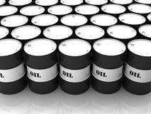 Black and white barrels. With mark OIL stacked in above-ground storage Stock Photo