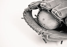 Black and White Baseball and Glove. A black and white vintage style of a glove and baseball shot in a studio Stock Photography