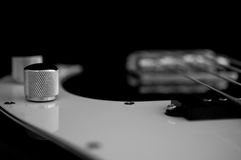 Black and white bass guitar. Royalty Free Stock Photo