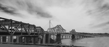 Black and White Bay Bridge. A black and white still of the old bay bridge being taken down with the new one in the background Stock Photography