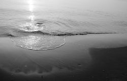 Black and White Beautiful sunrise on a beach in the summer Royalty Free Stock Images