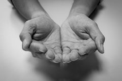 Black and white begging hands Stock Image
