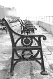 Black and white bench seats at seafront in Old Portsmouth Stock Photography